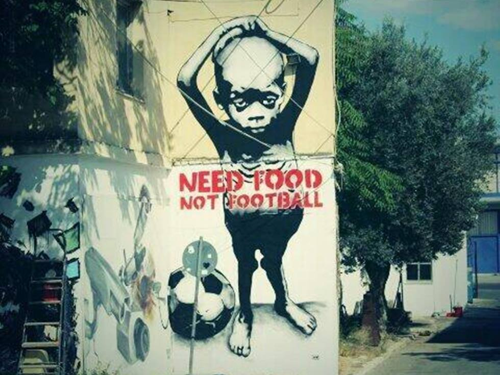 Mural-anti-mundial-brasil-2014-need-food-not-football