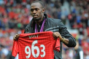 Bolt con la camiseta del United